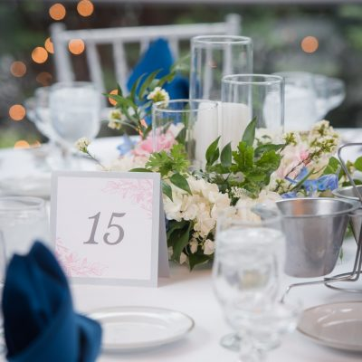 pink and blue table setting with matching table number