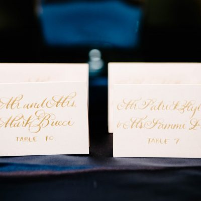 blush place cards with gold calligraphy