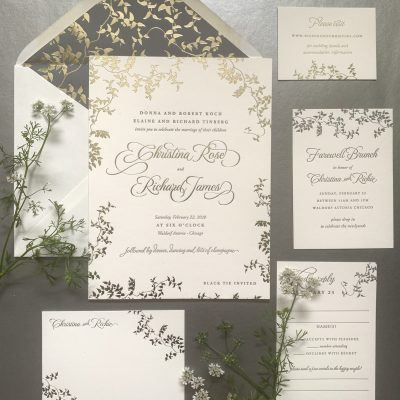 foil and letterpress wedding invitation with greenery design