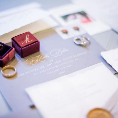 handmade paper wedding invitation with wax seal and ribbon