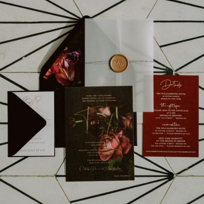 moody floral wedding invitation with vellum wrap twine and wax seal