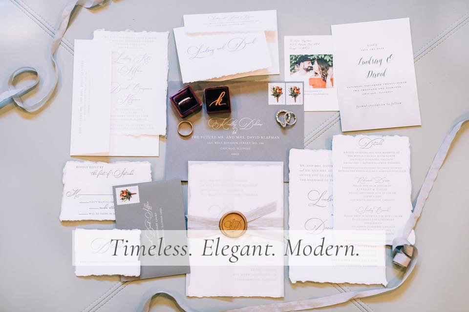 handmade paper wedding invitation with wax seal and ribbon and deckled edges